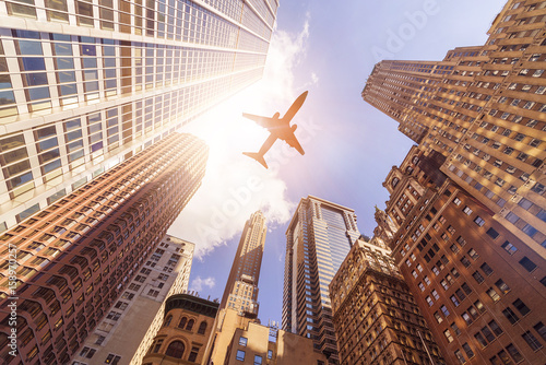 plane over highrise buildings