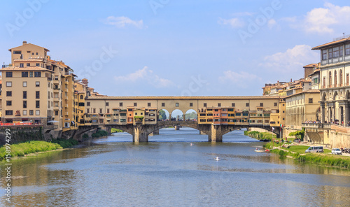 Florence - view of river Arno and Ponte Vecchio, Florence - view of the River Arno and Ponte Vecchio. Vasari's corridor connecting Palazzo Vecchio and Palazzo Pitti runs through upper part of bridge