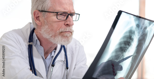 Doctor looking at x-ray - 158981251