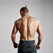 Back view of fitness man with athletic muscular torso. Concept of sport, exercise and lifestyle.