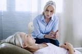 Senior woman undergoing hypnosis session - 159002275