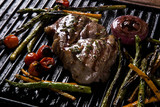 Ancho steak with grilled vegetables on the grill