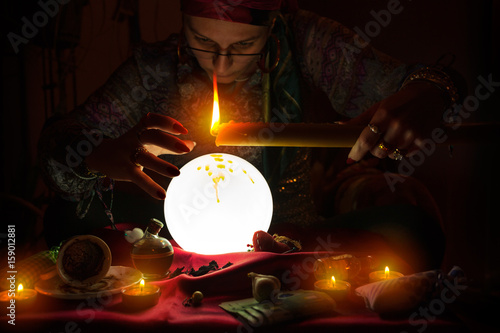 Plakát Fortune teller witch holding candle