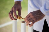 Referee putting bails on cricket stumps