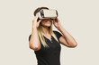 Young woman looking via virtual reality device