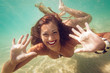 Cute Girl Swimming Under Sea