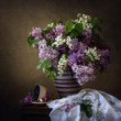 Still life with a bouquet of lilacs