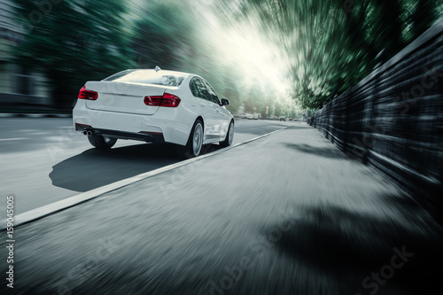 Foto op Canvas Stadion White car standing near high mountains at daytime