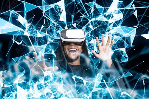 Smiling African guy in VR glasses, blue polygons