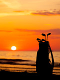 Idyllic shot of sunset and golf clubs