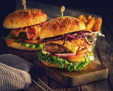 Delicious homemade hamburger on wooden background - 159067656