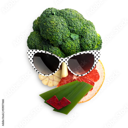 Tasty art / Quirky food concept of cubist style female face in sunglasses made of fruits and vegetables, on white background. - 159077666