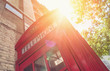 Red Telephone Booth with sun at summer in London street - 159102679