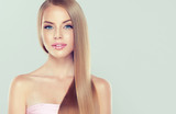 Fototapety Beautiful model girl with shiny brown straight long  hair . Care and hair products .