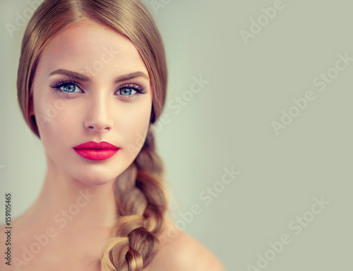Fototapeta Beautiful young woman with braid hair and red lips . Fashion ,beauty and cosmetics