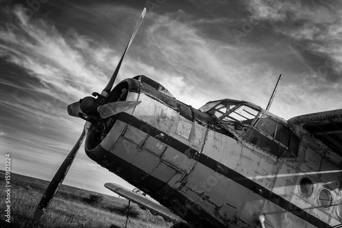 Fototapeta Old airplane on field in black and white