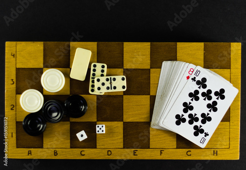 Various board games chess board, playing cards, dominoes плакат