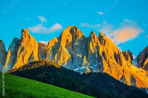 The cliffs illuminate the sunset Poster