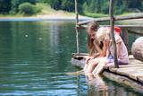 children on a wooden pier