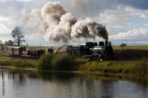 steam train at sandstone estates in south africa Poster