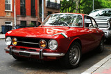 Retro old car red color on the road