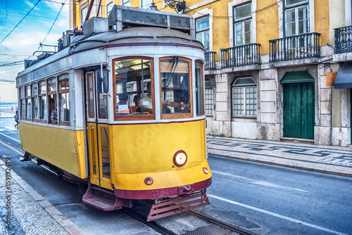 Lisbon, Portugal: the tram in the old town at sunrise Poster