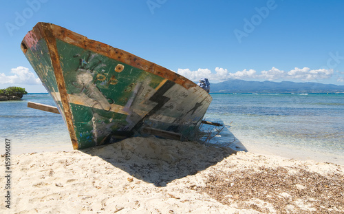 Wreck on white tropical beach - Le Gosier island - Guadeloupe Caribbean sea