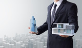 business man select modern house and building