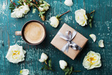 Morning cup of coffee, gift box and beautiful roses flowers on teal vintage table top view. Cozy Breakfast. Flat lay style. - 159199897