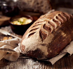 Rustic sourdough bread on wooden table