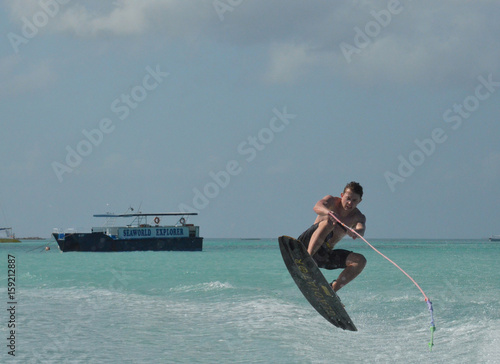 Póster Wakeboarder Nailing a Jump in the Ocean Off Aruba
