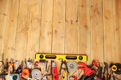 Plakat industrial tools on light wooden background with copy space