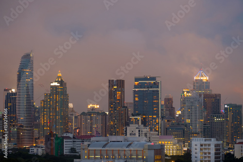 City / City and rain cloud at twilight.