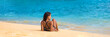 Beach relaxation woman lying down on sand banner. Tropical vacation travel lifestyle bikini mellow girl. Holiday woman relaxing enjoying sun on holidays.