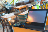 Fototapety Point of sale, POS , table credit card terminal in modern restaurant