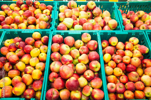Apples on boxes in supermarket