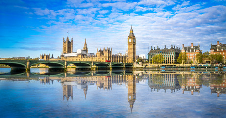 Big Ben and Westminster parliament with blurry refletion in London, United Kingdom at sunny day.