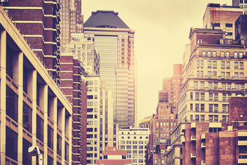 Retro toned picture of old Manhattan buildings, New York City, USA.