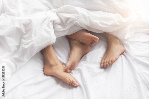Leinwandbild Motiv Young couple intimate relationship on bed passion