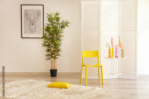Modern interior with yellow chair