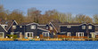 Black wooden resort houses Terherne