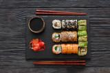 Set of sushi served on a stone slate