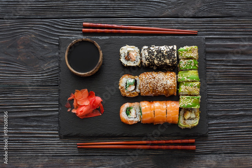 Foto op Canvas Sushi bar Set of sushi served on a stone slate