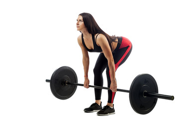 Young athletic sporty woman fitness model doing deadlift with barbell on white isolated background, position at bottom © Виталий Сова