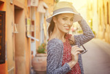 Fashionably dressed woman on the streets of a small Italian town - 159283803
