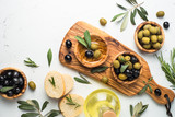 Black and green olives on white. Top view. - 159286691