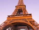 Historical place of Paris - the Eiffel tower. Fragment. Bottom view.