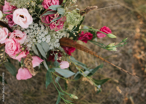 Poster wedding flowers composition in pink , purple and claret tones as background