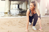 Woman jogging on the beach - 159314617