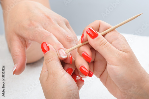 Cuticles care with cuticle pusher